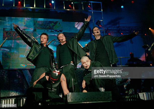 Ritchie Neville Jason Paul Brown and Scott Robinson Abz Love and Sean Conlon of Five performing on stage during the Brit Awards held at Earls Court...
