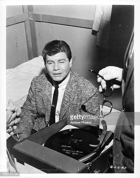 Ritchie Valens sits on bed in a scene from the film 'Go, Johnny, Go!', 1959.