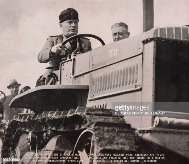 Benito Mussolini driving a farm tractor traces the boundaries of the city square reclamation of the Agro Pontino marshes from L'Illustrazione...
