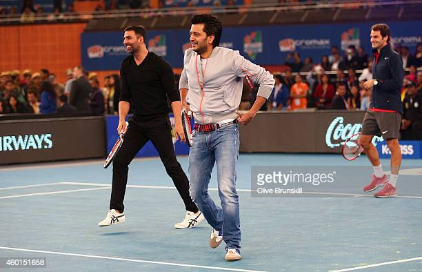 Riteish Deshmukh and Akshay Kumar plays tennis with Roger Federer of the Indian Aces during the CocaCola International Premier Tennis League third...