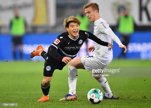 Ritso Doan of Bielefeld is challenged by Oscar Wendt of Moenchengladbach bi8during the Bundesliga match between DSC Arminia Bielefeld and Borussia...