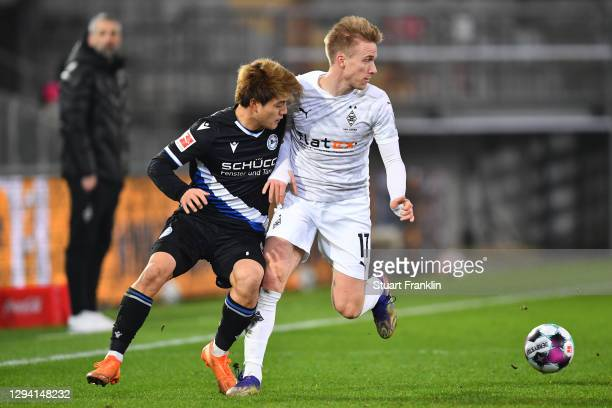 Ritso Doan of Bielefeld is challenged by Oscar Wendt of Moenchengladbach during the Bundesliga match between DSC Arminia Bielefeld and Borussia...