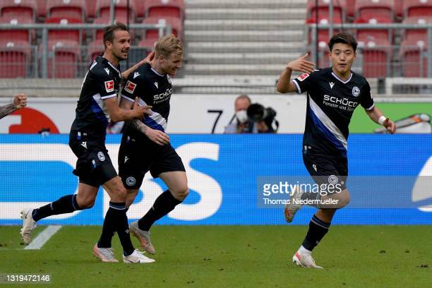 Ritsu Doan of Arminia Bielefeld celebrates after scoring their team's second goal with his team mates during the Bundesliga match between VfB...