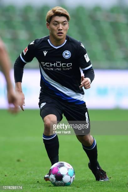 Ritsu Doan of Arminia Bielefeld runs with the ball during the Bundesliga match between SV Werder Bremen and DSC Arminia Bielefeld at Wohninvest...