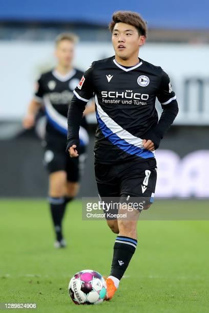 Ritsu Doan of Bielefeld runs with the ball during the Bundesliga match between DSC Arminia Bielefeld and 1. FSV Mainz 05 at Schueco Arena on December...