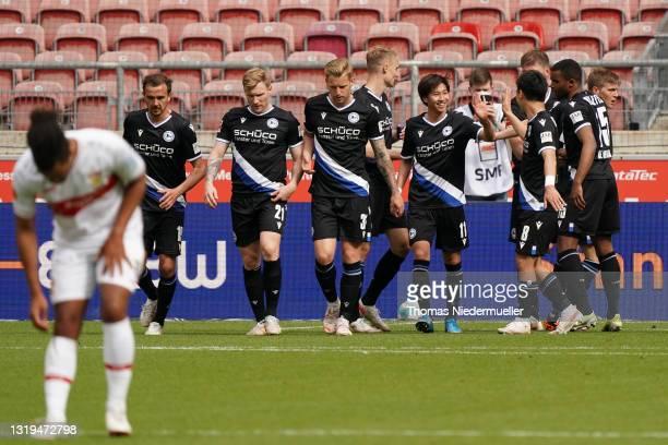 Ritsu Doan of DSC Arminia Bielefeld celebrates with teammate Masaya Okugawa after scoring his team's second goal during the Bundesliga match between...