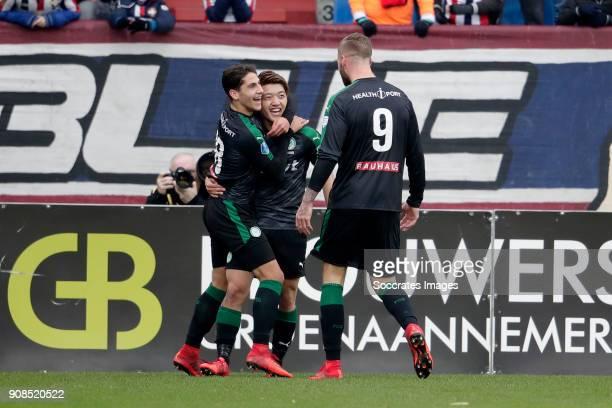 Ritsu Doan of FC Groningen celebrates 10 with Ludovit Reis of FC Groningen Lars Veldwijjk of FC Groningen during the Dutch Eredivisie match between...