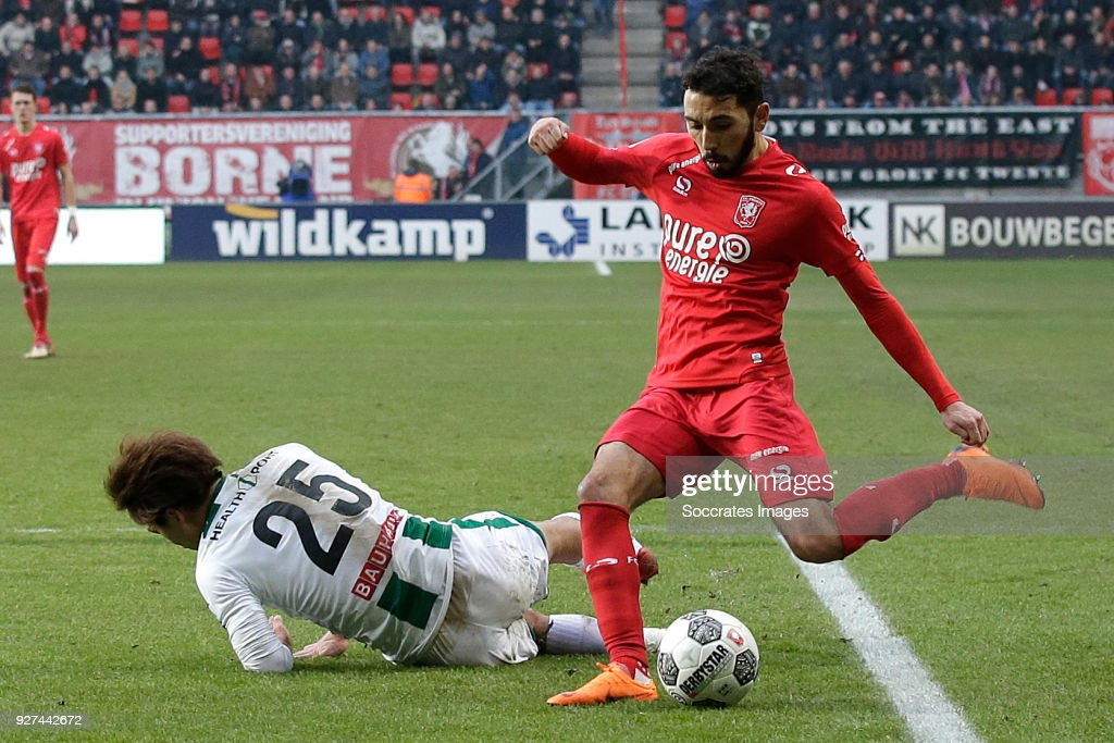 Ritsu Doan of FC Groningen , Cristian Cuevas of FC Twente during the Dutch Eredivisie match between Fc Twente v FC Groningen at the De Grolsch Veste on March 4, 2018 in Enschede Netherlands