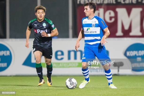 Ritsu Doan of FC Groningen Erik Bakker of PEC Zwolle during the Dutch Eredivisie match between PEC Zwolle and FC Groningen at the MAC3Park stadium on...