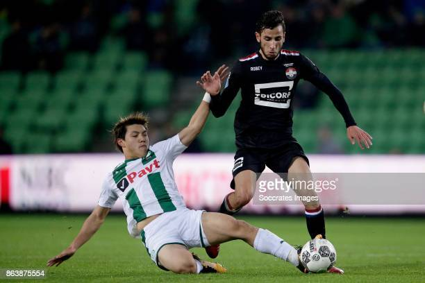 Ritsu Doan of FC Groningen Ismail Azzaoui of Willem II during the Dutch Eredivisie match between FC Groningen v Willem II at the Noordlease stadium...