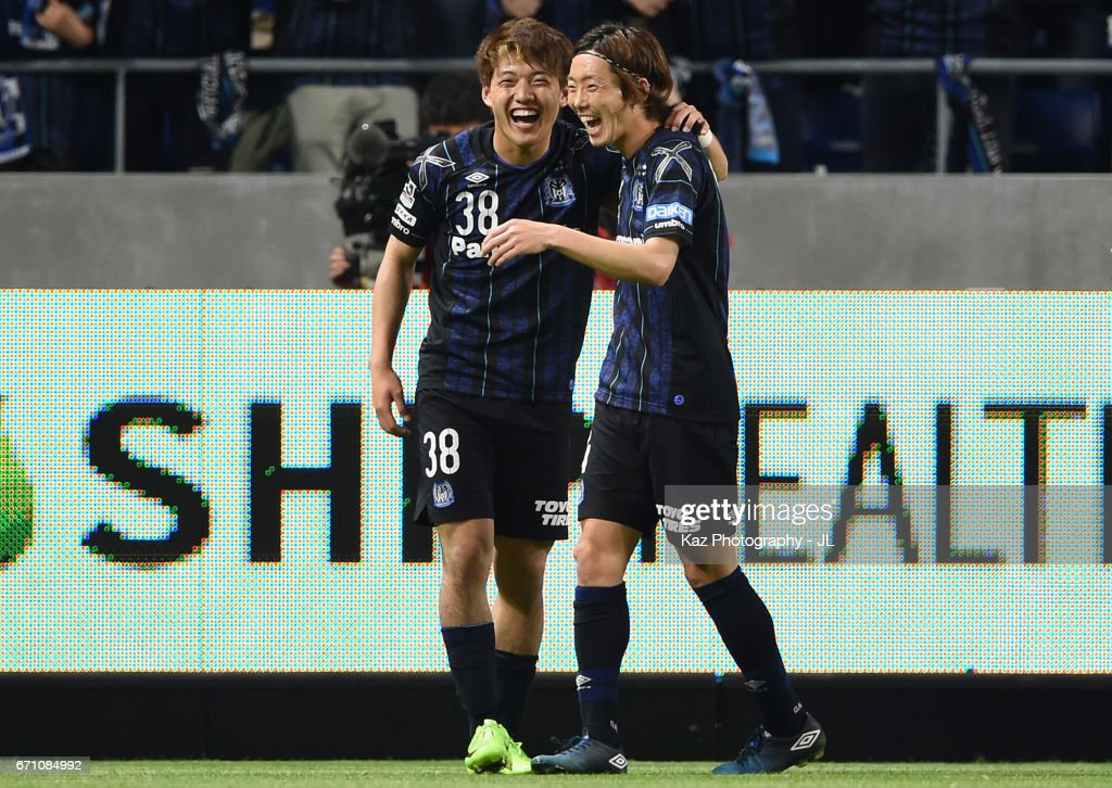 Ritsu Doan (L) of Gamba Osaka celebrates scoring his side's fourth goal with his team mate Hiroki Fujiharu (R) during the J.League J1 match between Gamba Osaka and Omiya Ardija at Suita City Football Stadium on April 21, 2017 in Suita, Osaka, Japan.