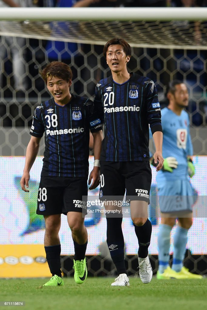 Ritsu Doan (L) of Gamba Osaka celebrates scoring his side's sixth goal with his team mate Shun Nagasawa (R) during the J.League J1 match between Gamba Osaka and Omiya Ardija at Suita City Football Stadium on April 21, 2017 in Suita, Osaka, Japan.