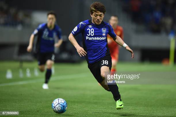 Ritsu Doan of Gamba Osaka competes for the ball during the AFC Champions League Group H match between Gamba Osaka v Adelaide United at Suita City...