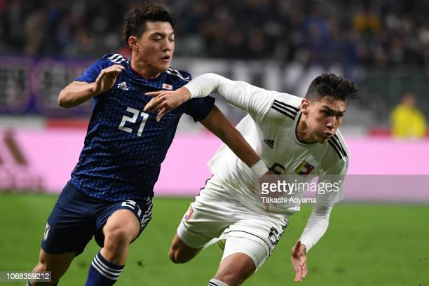 Ritsu Doan of Japan and Nahuel Ferraresi of Venezuela compete for the ball during the international friendly match between Japan and Venezuela at...