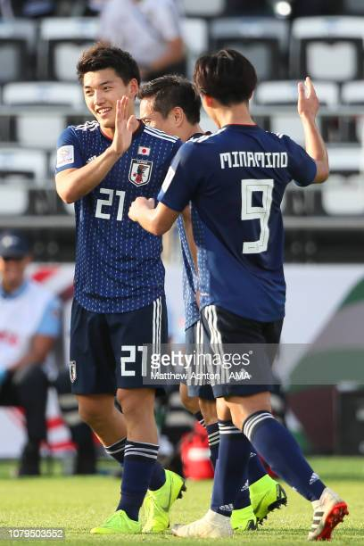 Ritsu Doan of Japan celebrates scoring a goal to make it 3-1 during the AFC Asian Cup Group F match between Japan and Turkmenistan at Al Nahyan...