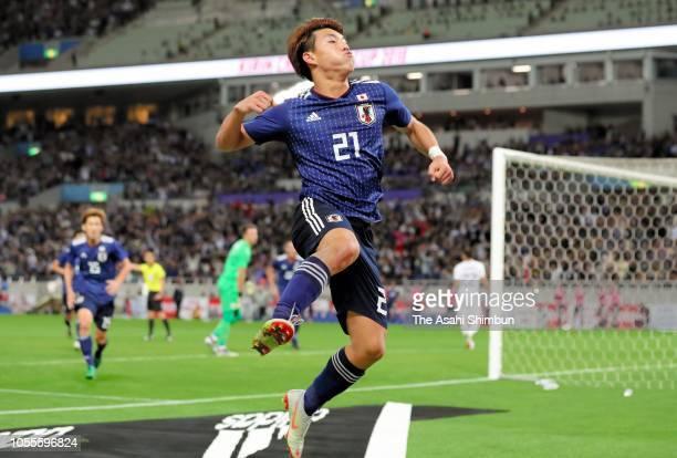 Ritsu Doan of Japan celebrates scoring his side's third goal during the international friendly match between Japan and Uruguay at Saitama Stadium on...