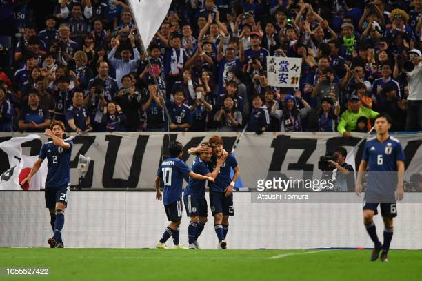 Ritsu Doan of Japan celebrates scoring his side's third goal with his team mates during the international friendly match between Japan and Uruguay at...