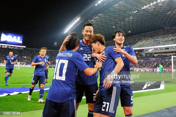 Ritsu Doan of Japan celebrates scoring his side's third goal with his team martes during the international friendly match between Japan and Uruguay...