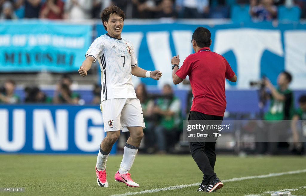 Ritsu Doan of Japan celebrates with head coach Atsushi Uchiyama after scoring his teams second goal during the FIFA U-20 World Cup Korea Republic 2017 group D match between South Africa and Japan at Suwon World Cup Stadium on May 21, 2017 in Suwon, South Korea.