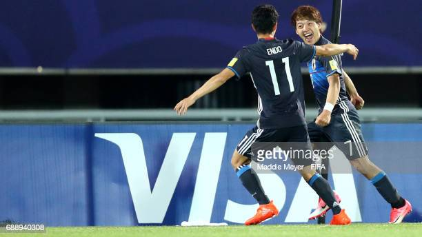 Ritsu Doan of Japan celebrates with Keita Endo after scoring his teams second goal during the FIFA U20 World Cup Korea Republic 2017 group D match...