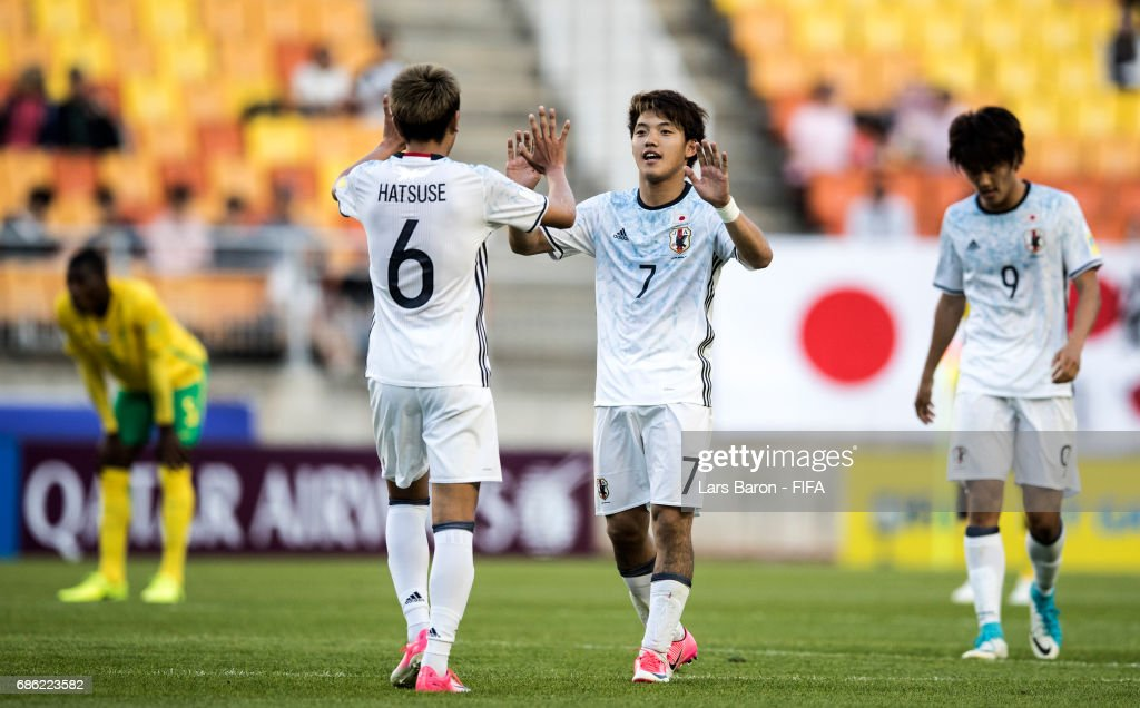 Ritsu Doan of Japan celebrates with Roy Hatsuse of Japan after winning the FIFA U-20 World Cup Korea Republic 2017 group D match between South Africa and Japan at Suwon World Cup Stadium on May 21, 2017 in Suwon, South Korea.