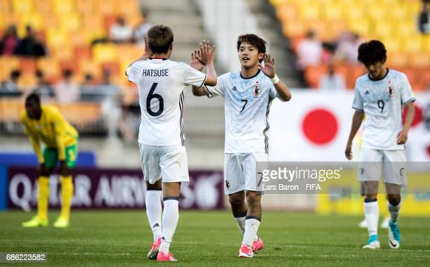 Ritsu Doan of Japan celebrates with Roy Hatsuse of Japan after winning the FIFA U20 World Cup Korea Republic 2017 group D match between South Africa...