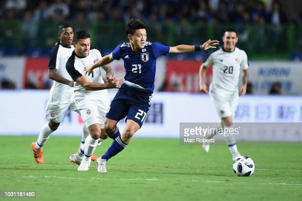 Ritsu Doan of Japan competes for the ball against Daniel Colindres of Costa Rica during the international friendly match between Japan and Costa Rica...