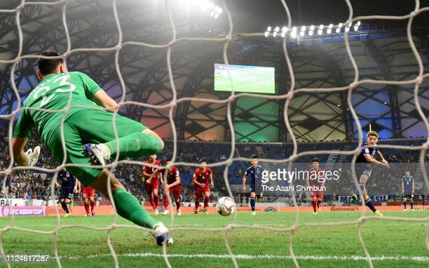 Ritsu Doan of Japan converts the penalty to score the opening goal from the penalty spot during the AFC Asian Cup quarter final match between Vietnam...