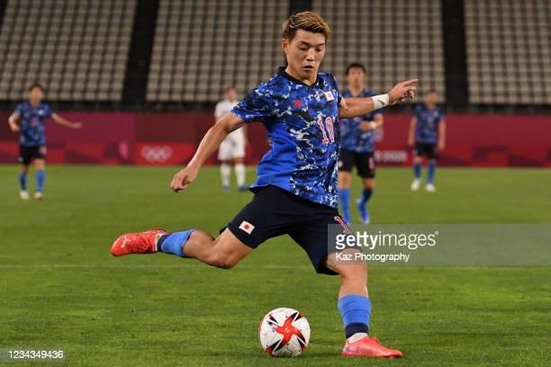 Ritsu Doan of Japan crosses the ball during the Men's Quarter Final match on day eight of the Tokyo 2020 Olympic Games at Kashima Stadium on July 31,...