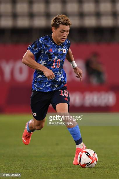 Ritsu Doan of Japan dribbles the ball during the Men's Quarter Final match on day eight of the Tokyo 2020 Olympic Games at Kashima Stadium on July...
