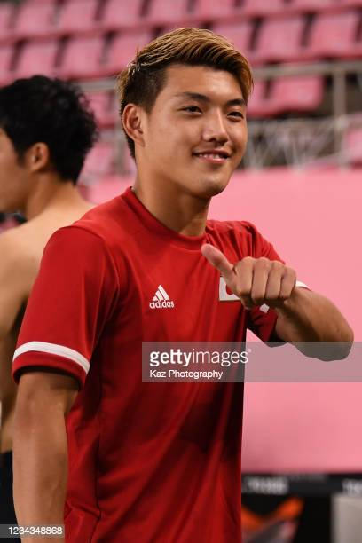 Ritsu Doan of Japan poses for photographers after the win during the Men's Quarter Final match on day eight of the Tokyo 2020 Olympic Games at...