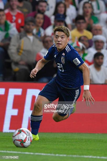 Ritsu Doan of Japan runs with the ball during the AFC Asian Cup semi final match between Iran and Japan at Hazza Bin Zayed Stadium on January 28,...