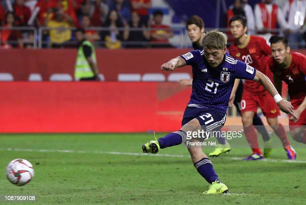 Ritsu Doan of Japan scores his sides first goal from the penalty spot during the AFC Asian Cup quarter final match between Vietnam and Japan at Al...