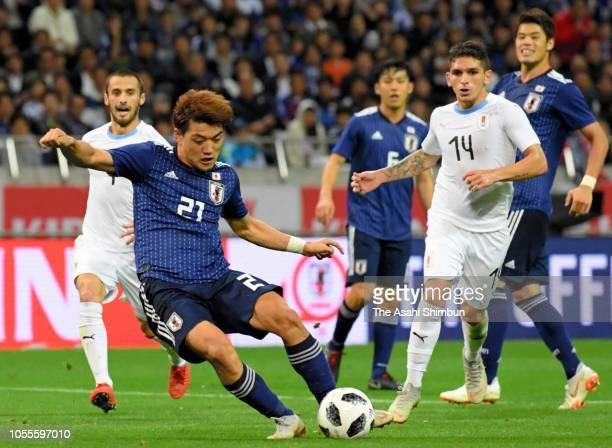 Ritsu Doan of Japan scores his side's third goal during the international friendly match between Japan and Uruguay at Saitama Stadium on October 16,...
