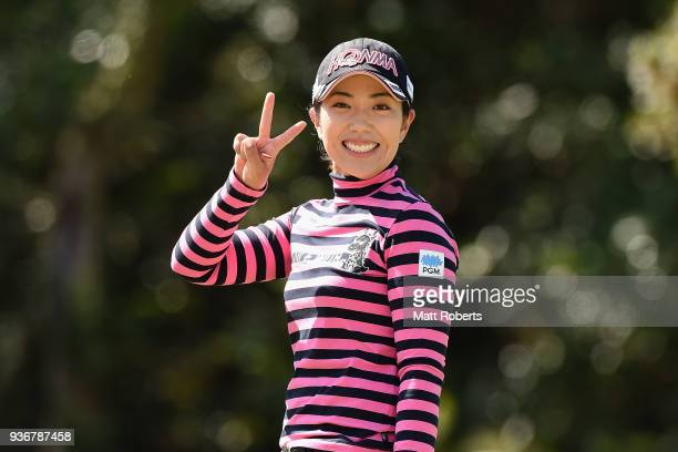 Ritsuko Ryu of Japan celebrates after hitting a hole in one on the 2nd hole during the first round of the AXA Ladies Golf Tournament In Miyazaki at...