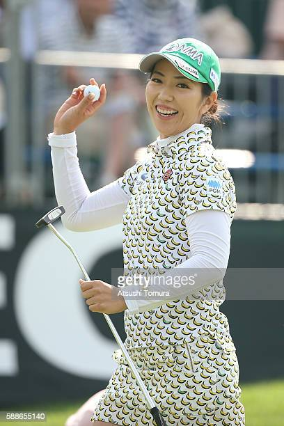 Ritsuko Ryu of Japan celebrates after making her birdie putt on the 18th hole during the first round of the NEC Karuizawa 72 Golf Tournament 2016 at...