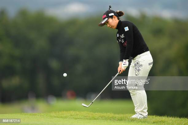 Ritsuko Ryu of Japan chips onto the 11th green during the first round of Stanley Ladies Golf Tournament at the Tomei Country Club on October 6, 2017...