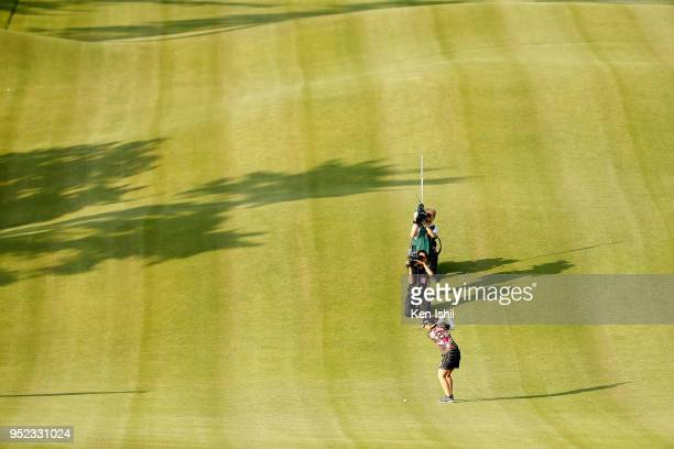 Ritsuko Ryu of Japan hits an approach shot on the 18th hole during the second round of the CyberAgent Ladies Golf Tournament at Grand fields Country...
