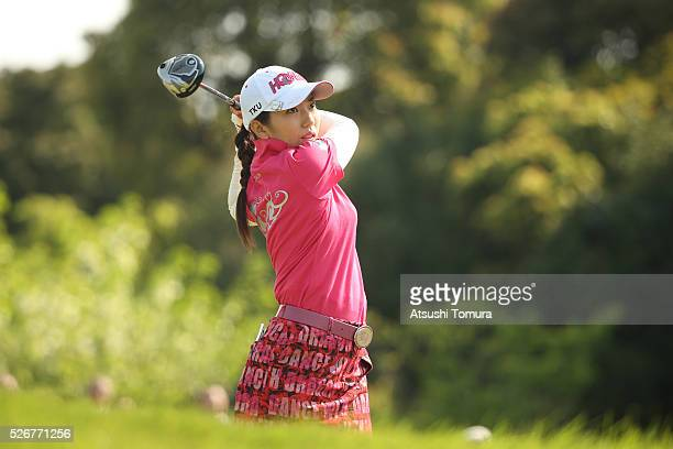 Ritsuko Ryu of Japan hits her tee shot on the 1st hole during the final round of the CyberAgent Ladies Golf Tournament at the Grand Fields Country...