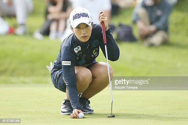 Ritsuko Ryu of Japan lines up her putt on the 18th green during the first round of the Nobuta Group Masters GC Ladies at the Masters Golf Club on...