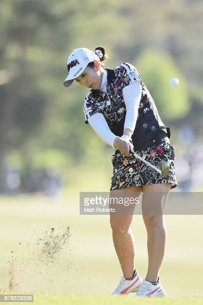 Ritsuko Ryu of Japan plays her approach shot on the 7th hole during the first round of the World Ladies Championship Salonpas Cup at the Ibaraki Golf...