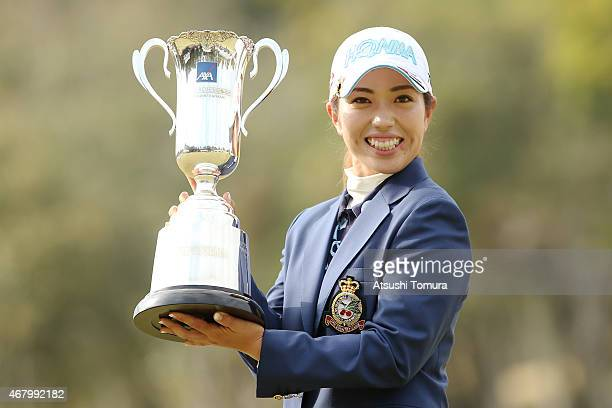 Ritsuko Ryu of Japan poses with the trophy after winning the AXA Ladies Golf Tournament at the UMK Country Club on March 29 2015 in Miyazaki Japan
