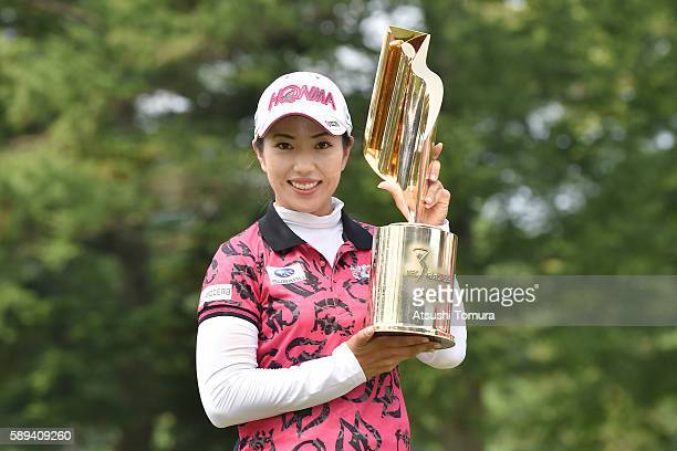 Ritsuko Ryu of Japan poses with the trophy after winning the NEC Karuizawa 72 Golf Tournament 2016 at the Karuizawa 72 Golf North Course on August 14...