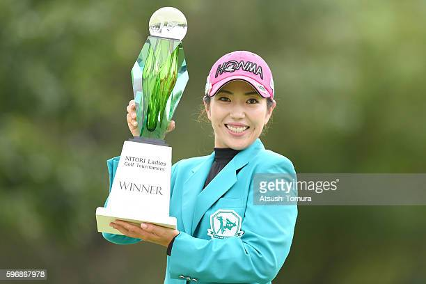 Ritsuko Ryu of Japan poses with the trophy after winning the Nitori Ladies 2016 at the Otaru Country Club on August 28 2016 in Otaru Japan