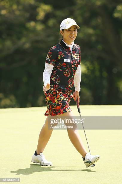 Ritsuko Ryu of Japan smiles after making her birdie putt on the 14th green during the second round of the HokennoMadoguchi Ladies at the Fukuoka...