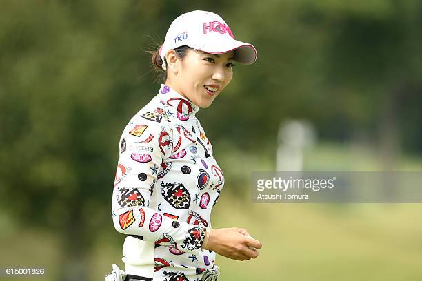 Ritsuko Ryu of Japan smiles after making her birdie putt on the 5th green during the final round of the Fujitsu Ladies 2016 at the Tokyu Seven...