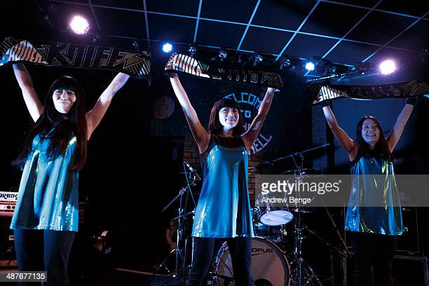 Ritsuko Taneda Emi Morimoto and Naoko Yamano of Shonen Knife perform on stage at Brudenell Social Club on May 1 2014 in Leeds United Kingdom