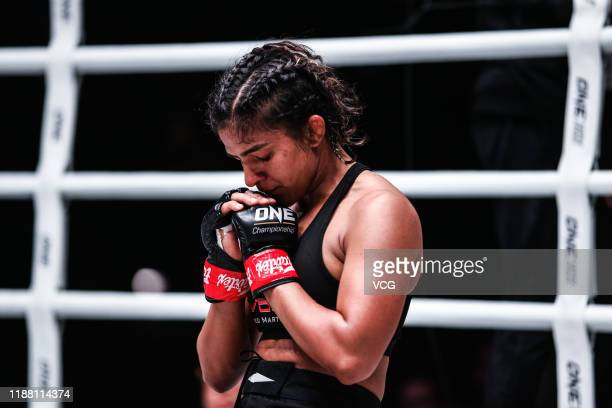 Ritu Phogat of India celebrates after defeating Nam Hee Kim of South Korea during 2019 ONE Championship at Cadillac Arena on November 16, 2019 in...