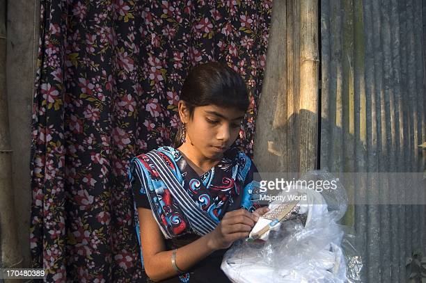 Ritu reads in class seven in Uchutia High School After school she earns money by sewing clothes to support her family Manikganj Bangladesh February...
