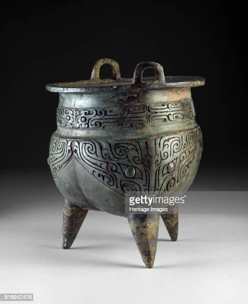 Ritual food vessel or li ding with taotie masks Shang Dynasty Erligang Period Dimensions height 197 cmdiameter 12 cm